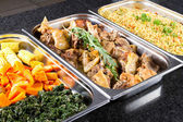 Buffet style food in trays — Stok fotoğraf