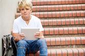 Teen boy using tablet computer — Stock Photo