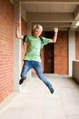 Happy high school student jumping up — Stock Photo
