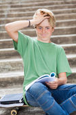 Teen boy looking frustrated while reading — Stock Photo