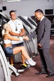 Gym manager greeting customer — Stock Photo