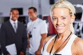 Pretty female gym trainer — Stock Photo