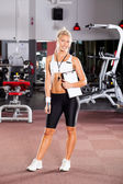 Young female gym instructor — Stock Photo