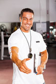 Friendly personal trainer hand shake — Foto Stock