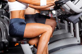 Group of women cycling in gym — Stockfoto