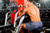 Man working out with barbell — Stok fotoğraf