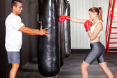 Fitness woman training with punch bag — Stock Photo