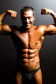 Bodybuilder on black background — Stock Photo
