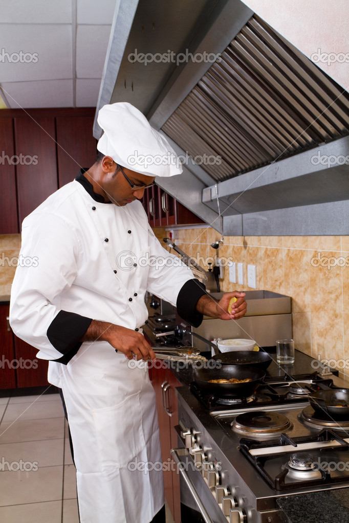 Professional chef cooking in commercial kitchen stock for Kitchen plus 2000 vs 3000