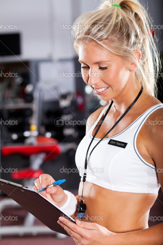 Young female school gym teacher — Stock Photo #10678428
