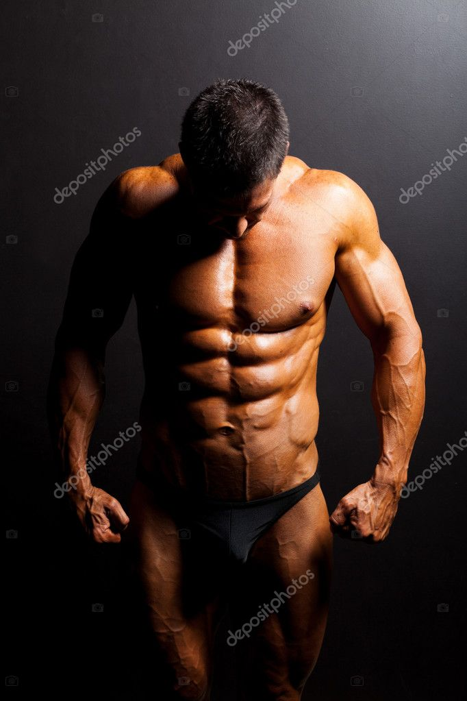 Muscular man's body in studio light — Stock Photo #10679075