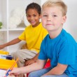 Kindergarten boys in classroom — Stock Photo