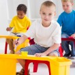 Group of preschool kids in classroom — Stock Photo #10683020