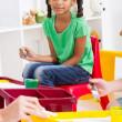 Preschool girl in classroom — Stock Photo