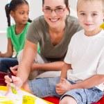 Preschool teacher and kids — Stock Photo