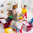 Stock Photo: Preschool teacher and students in classroom