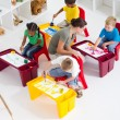 Overhead view of preschool students and teacher — Stock Photo
