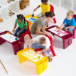 Overhead view of preschool students and teacher — Stock Photo