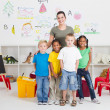 Kindergarten kids and teacher - Stock Photo