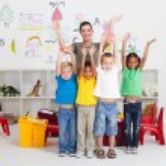 Cheerful preschool kids and teacher — Stock Photo