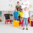 Stockfoto: Preschool boy holding his painting in front of class