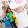 Proud kindergarten boy holding painting high — Stock Photo