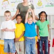 Preschool class winning a trophy — Stock Photo