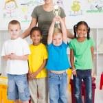 Preschool class winning a trophy — Stock Photo