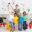 Reschool kids and teacher with flags in classroom — Stock fotografie