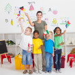 Reschool kids and teacher with flags in classroom — ストック写真
