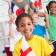 Foto de Stock  : Group of preschool kids and teacher with flags in classroom