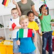 Group of preschool kids with flags — Stock Photo