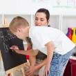 Preschool boy and teacher — Stock Photo