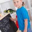 Preschool boy in front of blackboard — Stock Photo #10683363