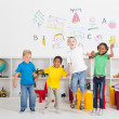 Group of cheerful preschool kids jumping up — Stock Photo