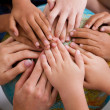 Diversity kids hands together on globe — Stock Photo