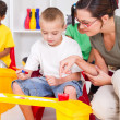 Kindergarten teacher and preschool students — Stock Photo #10683571