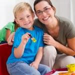 Happy preschool boy and teacher — Stock Photo