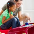 Caring teacher help preschool girl painting picture — Stock Photo