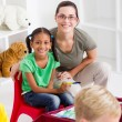 Happy preschool teacher and students — Stock Photo #10683726