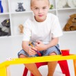 Preschool boy paint in classroom — Stock Photo