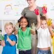 Group of preschool kids with hand paint in classroom — Stock Photo