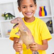 Preschool boy playing with dinosaur — Stock Photo