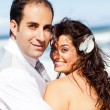 Happy groom and bride on beach — Stock fotografie