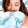 Stock Photo: Bride smelling bouquet