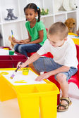 Kindergarten kids painting — Stock Photo