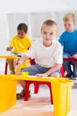 Group of preschool kids in classroom — Stock Photo