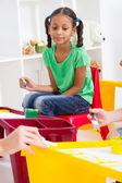 Preschool girl in classroom — Stock Photo