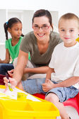 Preschool teacher and kids — Stock Photo
