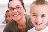 Closeup of preschool boy and teacher — Stock Photo